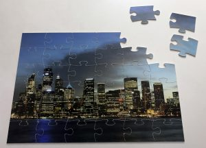 puzzle skyline pieces together